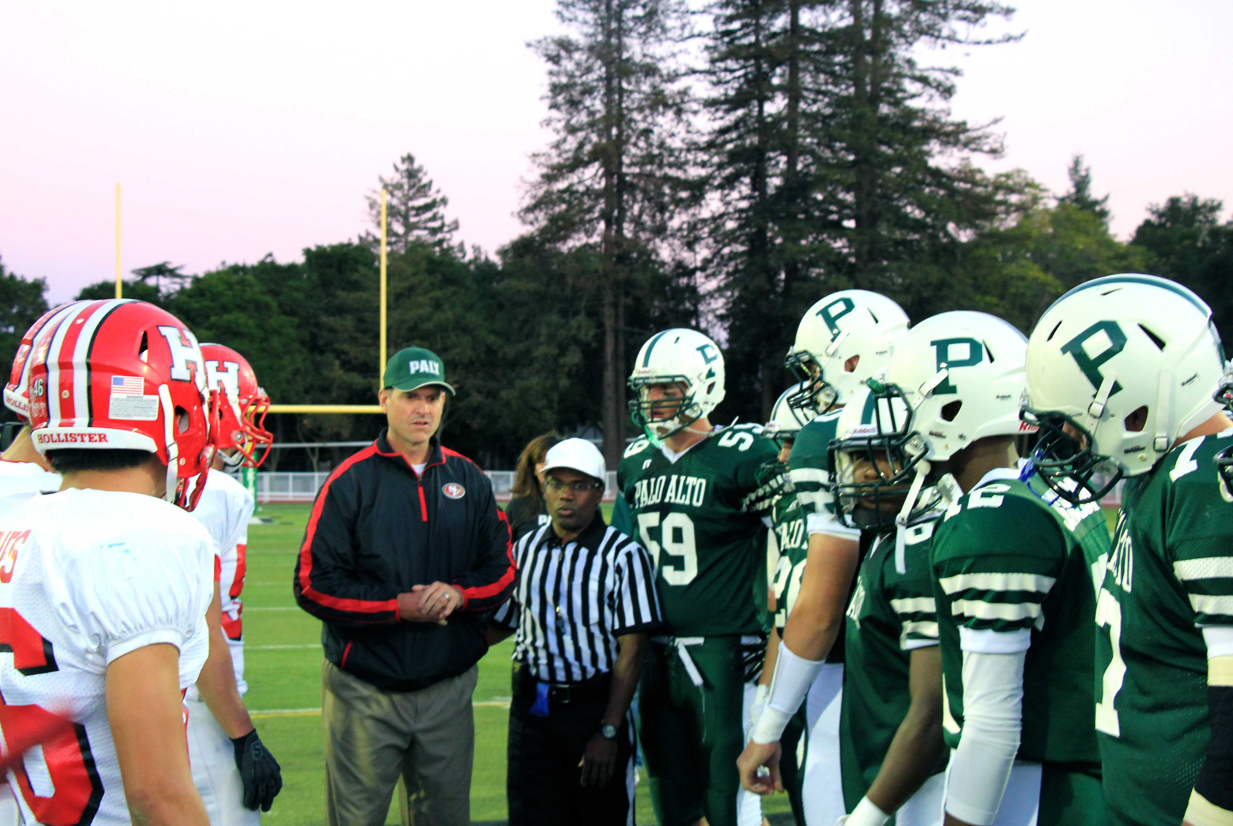 49ers coach Jim Harbaugh flips the coin at Palo Alto High School's football season opener against San Benito High School. Photo by Scott Andrews