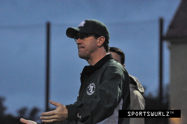 The Paly boys' lacrosse ex-head coach Craig Conover talks to the referee during a game last season. Conover recently announced that he would be leaving the team this year for a new position he accepted at a start-up company. The Vikings' season begins in Feb. 2014. Photo from sportswurlz.com