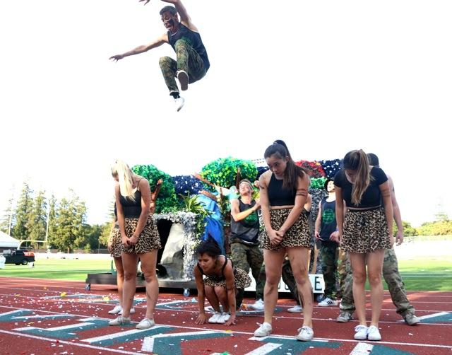 "Senior Kenny Rapaport takes a leap in the grades' spirit dance, themed 'Survival of the Fittest."" Photo by Cathy Rong."