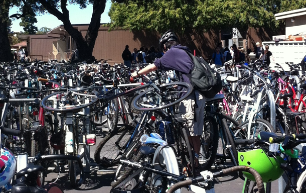 Junior Haruhiko Kuramochi struggles to remove his bike from the crowded bike racks after school. Photo by Lizzie Chun.