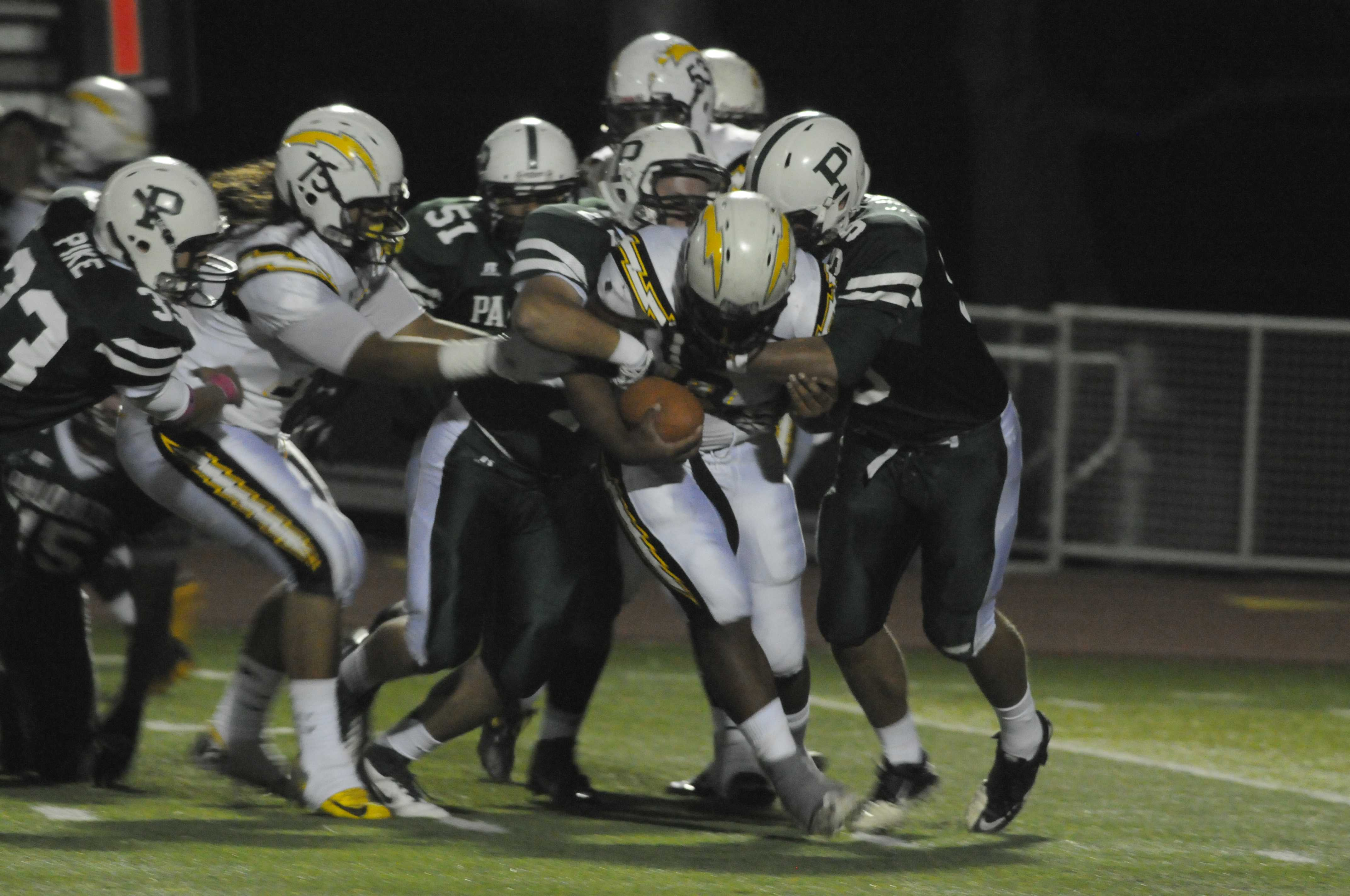 The Paly defensive line ties up a Wilcox player. Wilcox rushed for 540 of their 543 total yards. Photo by Liana Pickrell.