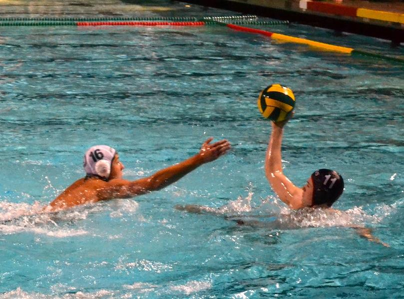 Sophomore utility Winston Rosati attempts to block a shot from Gunn sophomore Christian Znidarsic. Rosati had one of the Vikings' four goals on the evening.
