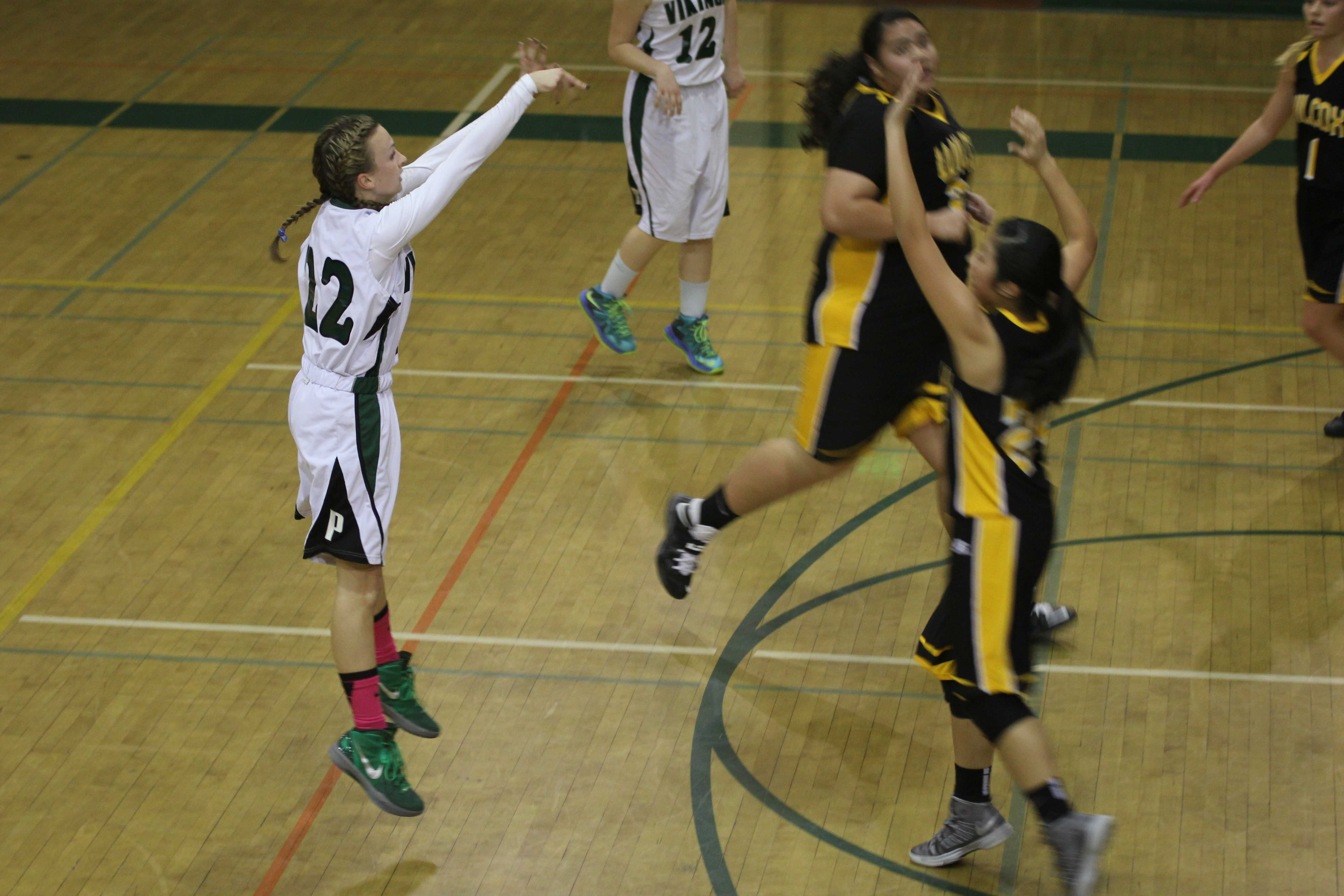 Sophomore Maddy Atwater follows through on a three-pointer. Photo by Maddy Jones.