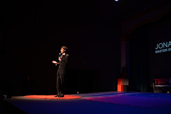 Senior Jonathan Mackris introduces himself as the Master of Ceremonies at TEDxPaloAltoHighSchool. Photo courtesy of TEDxPaloAltoHighSchool