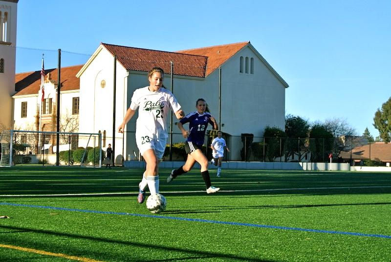Senior Julia Kwasnick runs the ball down the field. Photo by Julianna Heron.