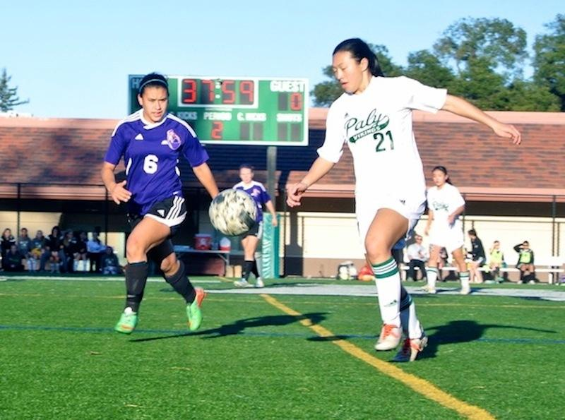 Sophomore Alison Lu gets ready to kick the ball down the field past the Monta Vista player, junior Janaye Sakkas. Photo by Julianna Heron.