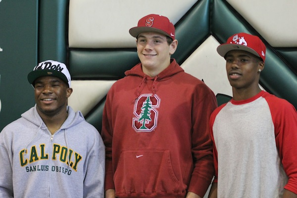 Seniors Malcolm Davis, Keller Chryst and Keesean Johnson are all smiles.
