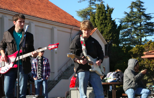 "Seniors Jack Krasnow and Corbin Dodd jam together on stage during a lunchtime ""Paly Rocks"" performance in December. Dodd is highly involved in Open Mic Nights. Photo by Cathy Rong."