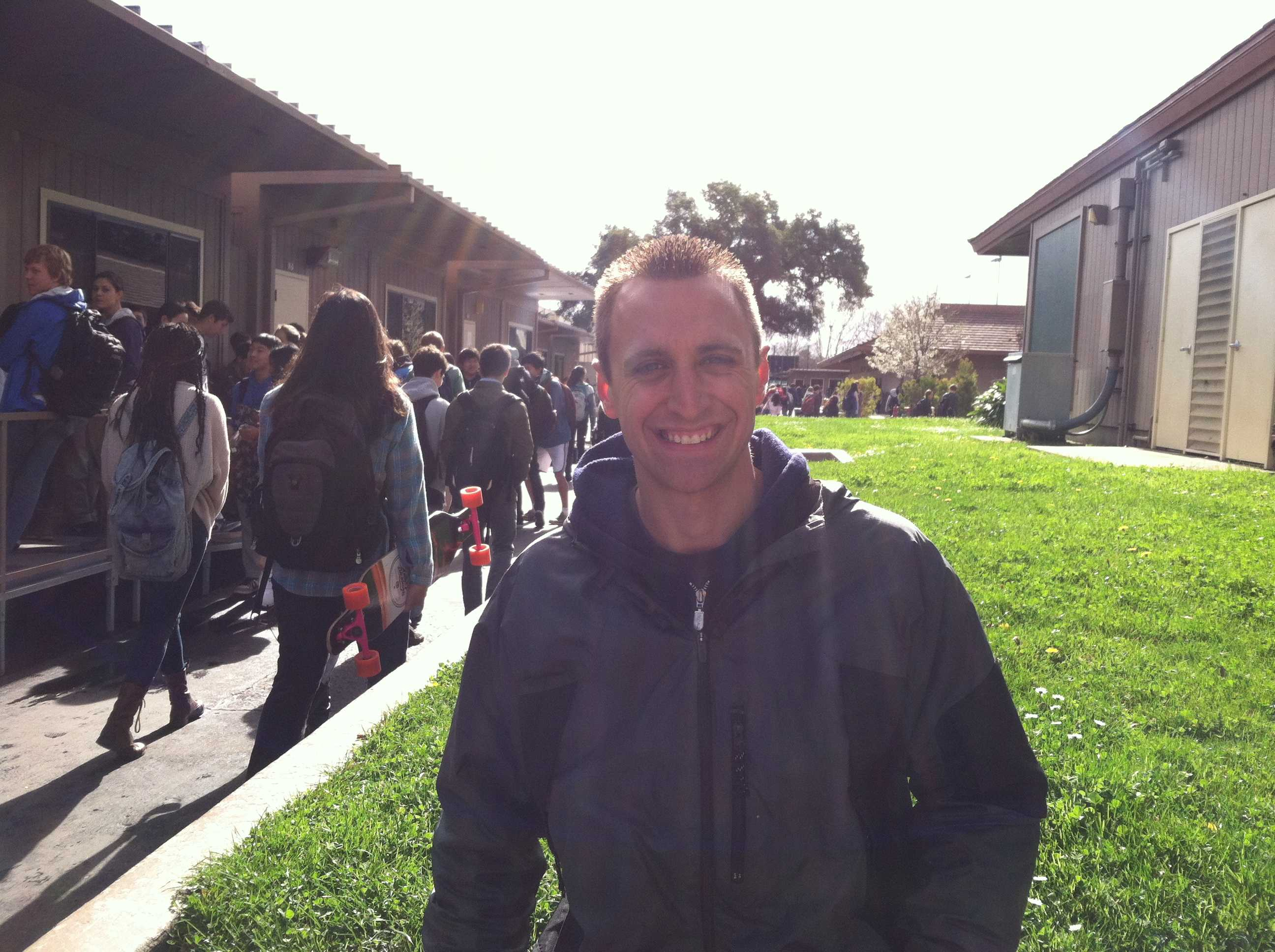 New Paly Campus Supervisor, Chase Hartmann, smiles on the job. Photo by Maddy Jones.