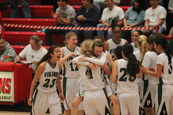 The Vikings celebrate after their 57-54 win over the Mountain View Spartans in the CCS quarterfinals. Photo by Maddy Jones.