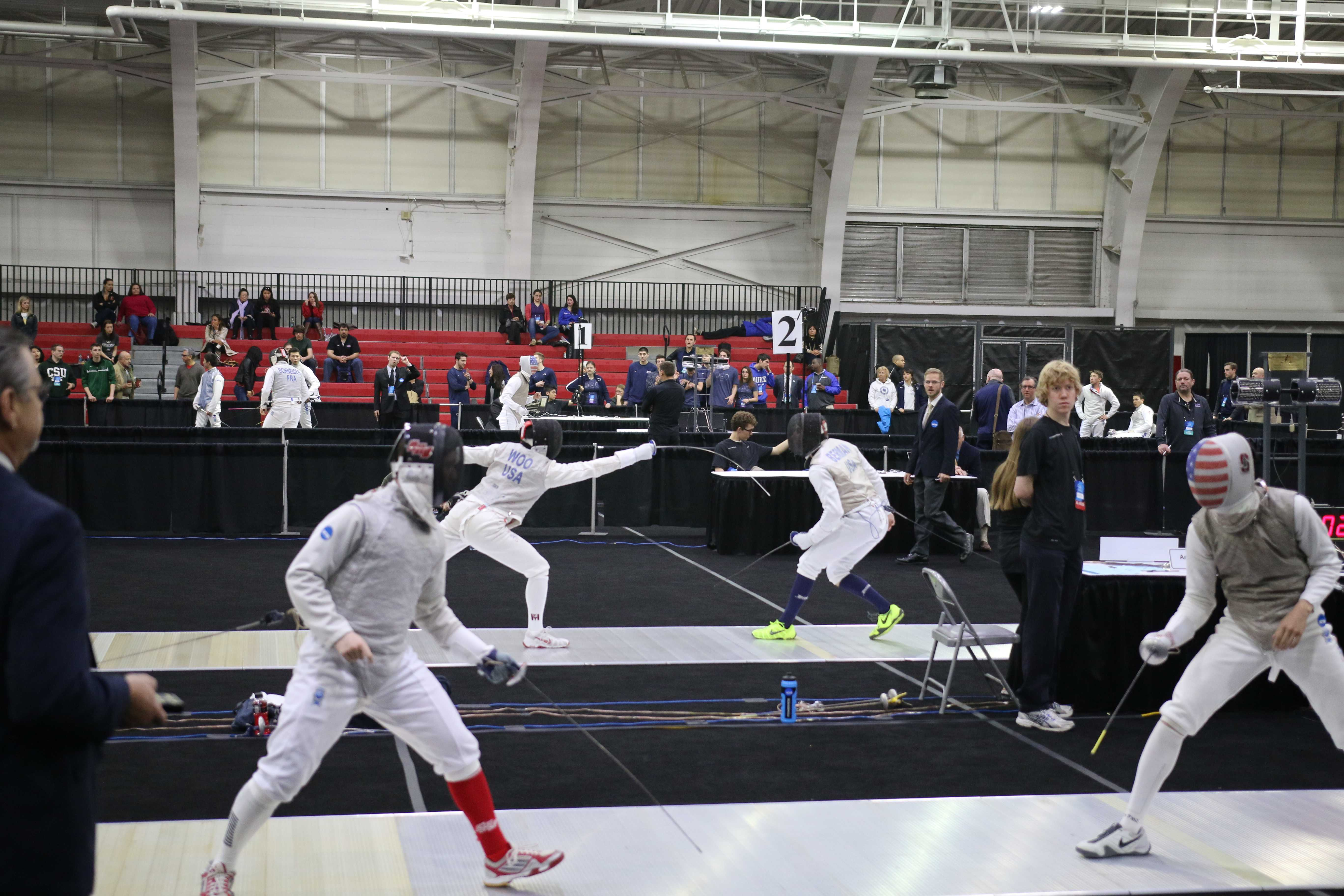 Noah Berman (right) of Brandeis fenced Michael Woo (left) of Harvard on the far strip at the 2014 NCAA Championships. Photo by Steven Berman.