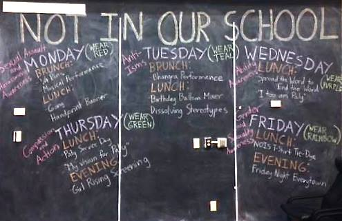 The library blackboard outlines the events and activities that will take place next week during Not In Our Schools week. Not In Our Schools week starts Monday with different bullying-related issues focused on each day. There will be various activities, from music performances to tie dying shirts, happening during the week. Photo by Julianna Heron.