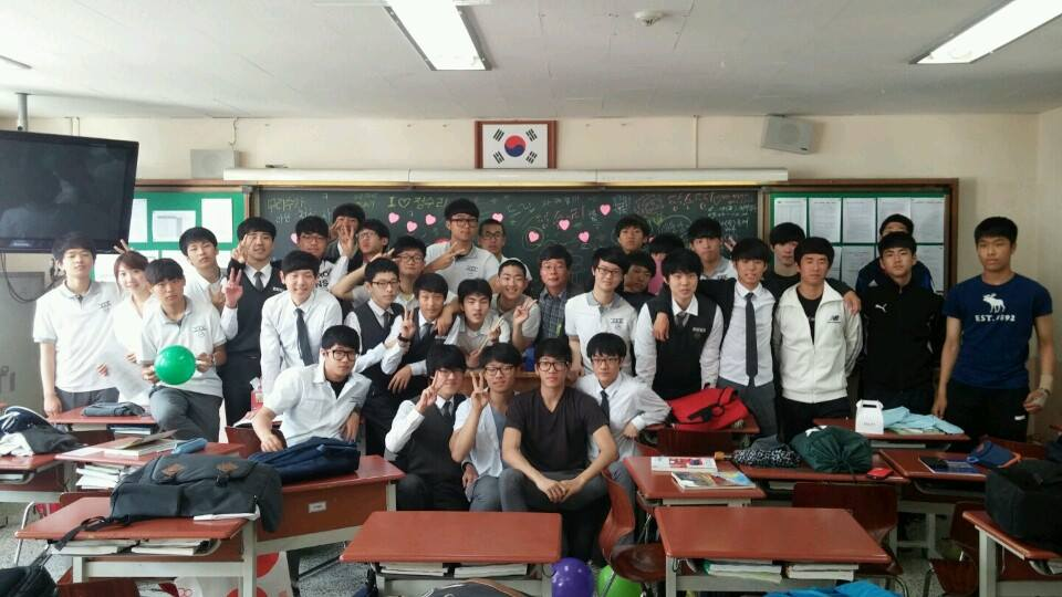 Henry Do Hyun Kwan, former Paly student, stands with his new class in South Korea.