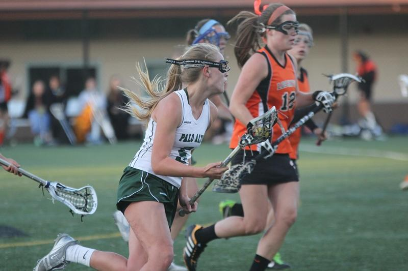 Junior midfielder Paige Bara sprints down the field with the ball. Photo by Maddy Jones.