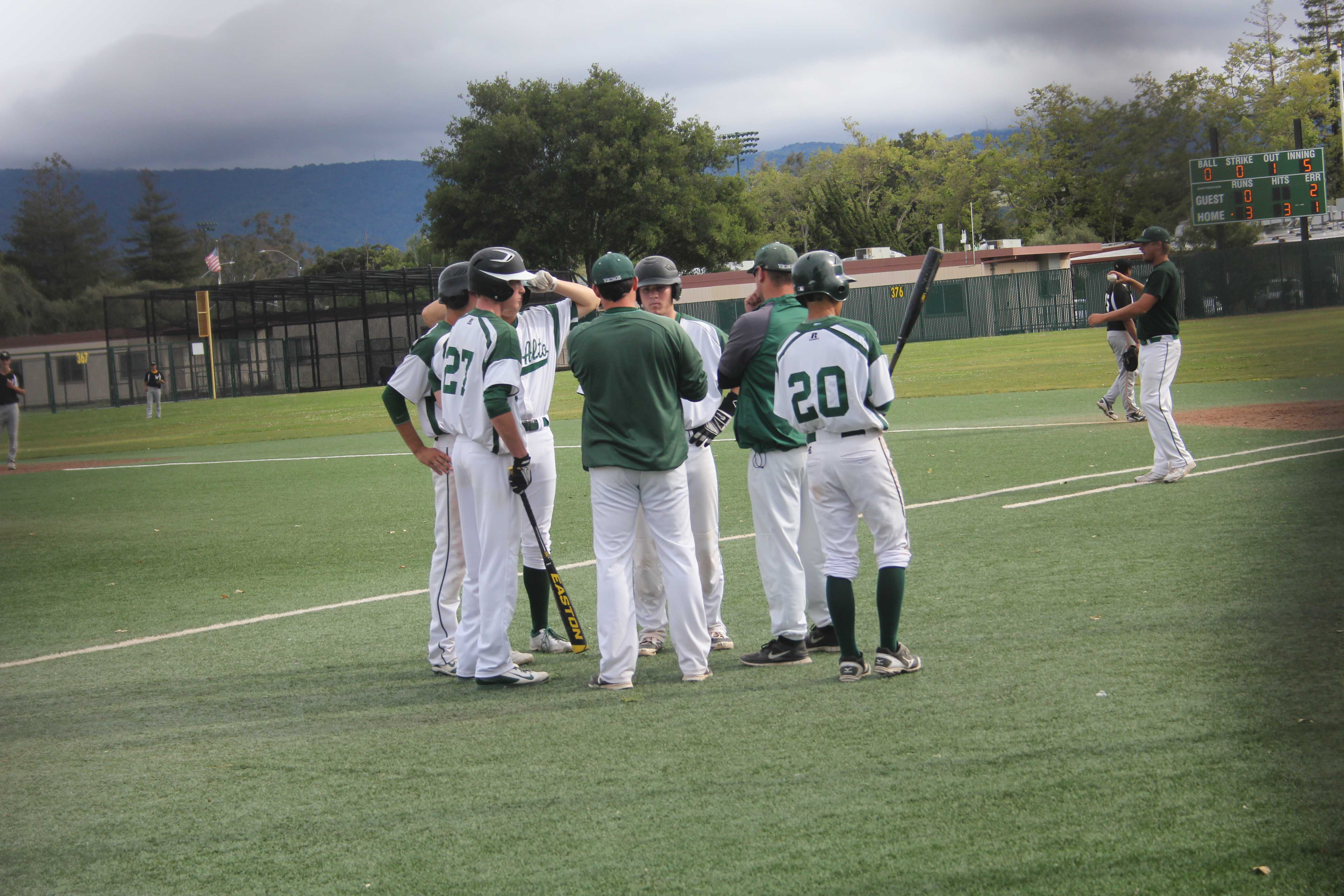 Paly head coach Erik Raich talks it over during a Wilcox pitching change.  Paly went on to win the contest 5-0 and clinching a SCVAL championship series birth.