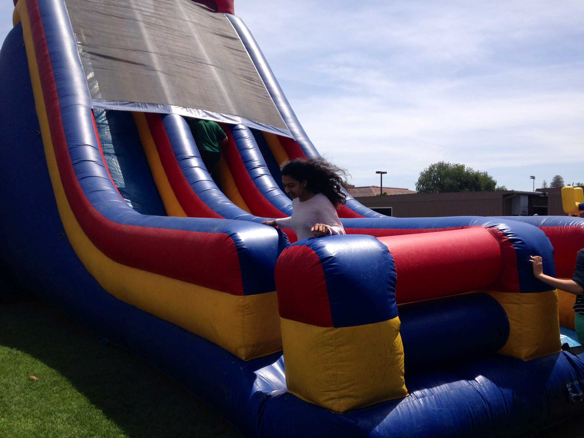 Junior Meera Bhide exits a large, blow-up slide that is included at every field day. Photo by Amanda Carlsson.
