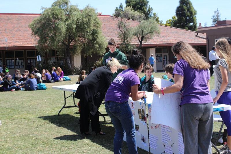"""Best Buddies Club President Kate Marinkovich and club member Rachel _____ lead a booth on """"Ability Awareness"""" day of Not in Our Schools week. Photo by Becca Raffel."""