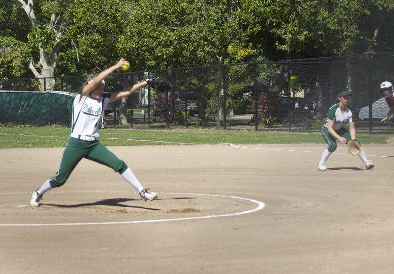 Senior Julia Saul pitches to a Fremont player in the first inning.