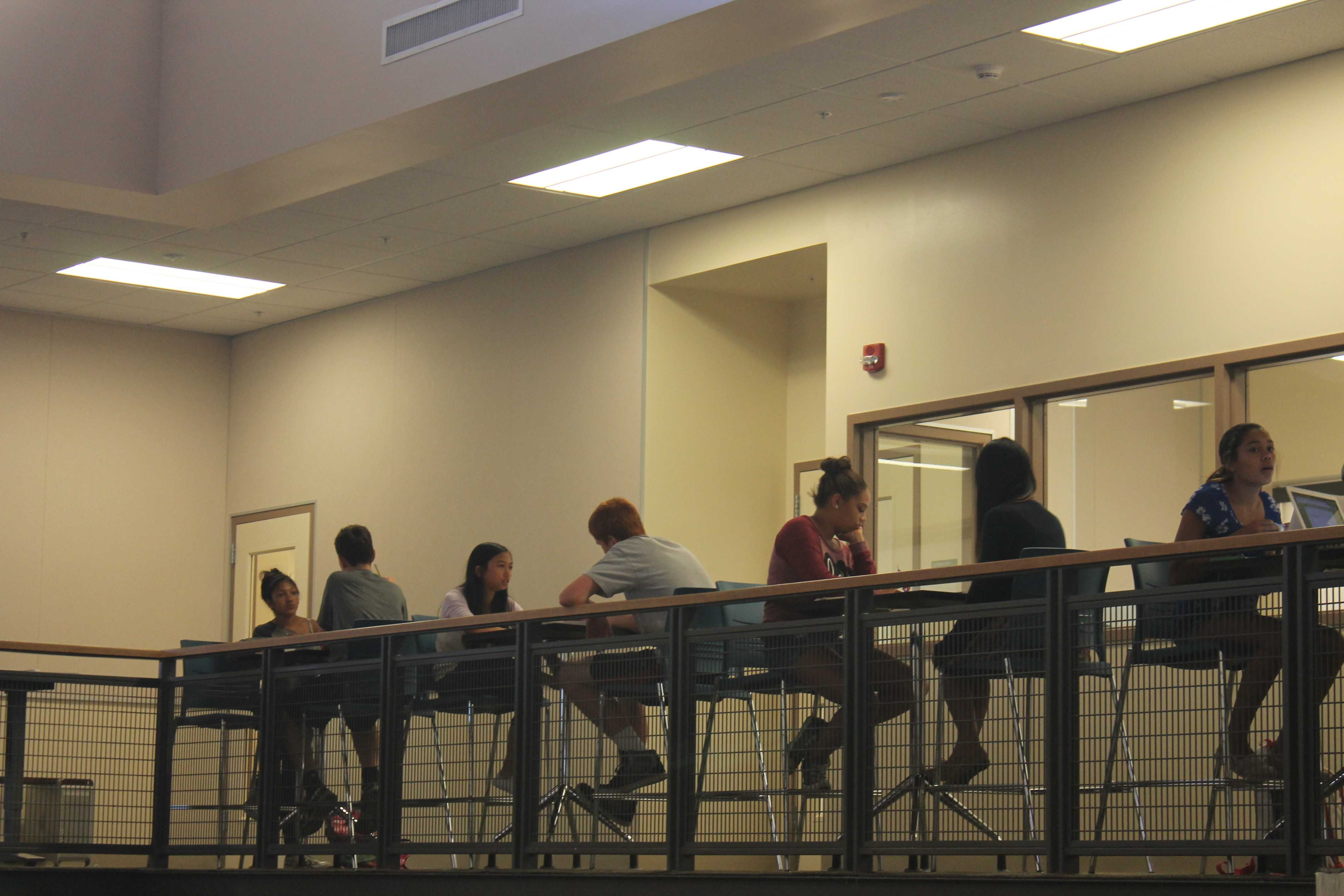 Students study at high-rise tables on the second floor of the Media Arts Center. Photo by Adele Bloch.