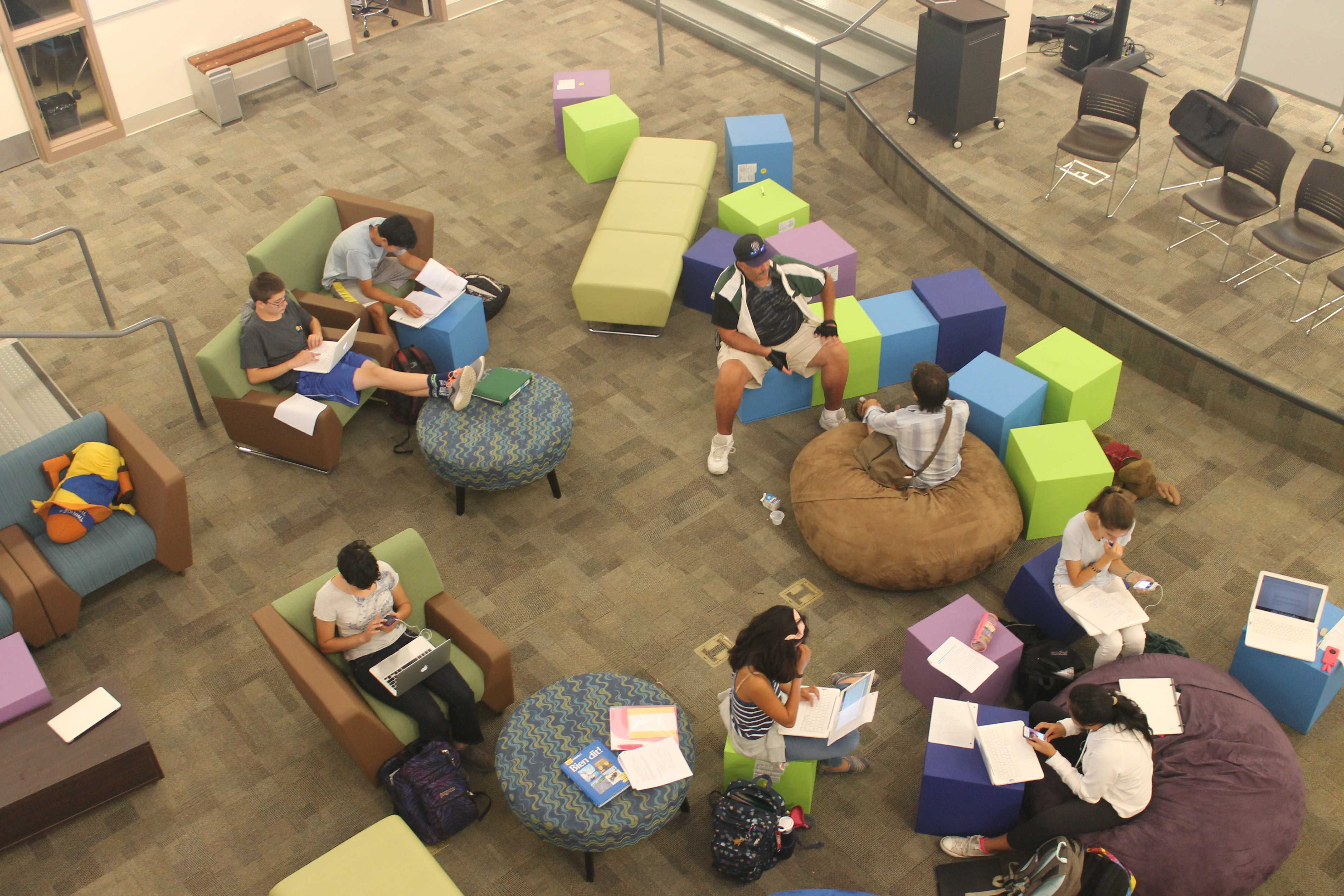Students enjoy the new, modern furniture of the Media Arts Center. Photo by Adele Bloch.