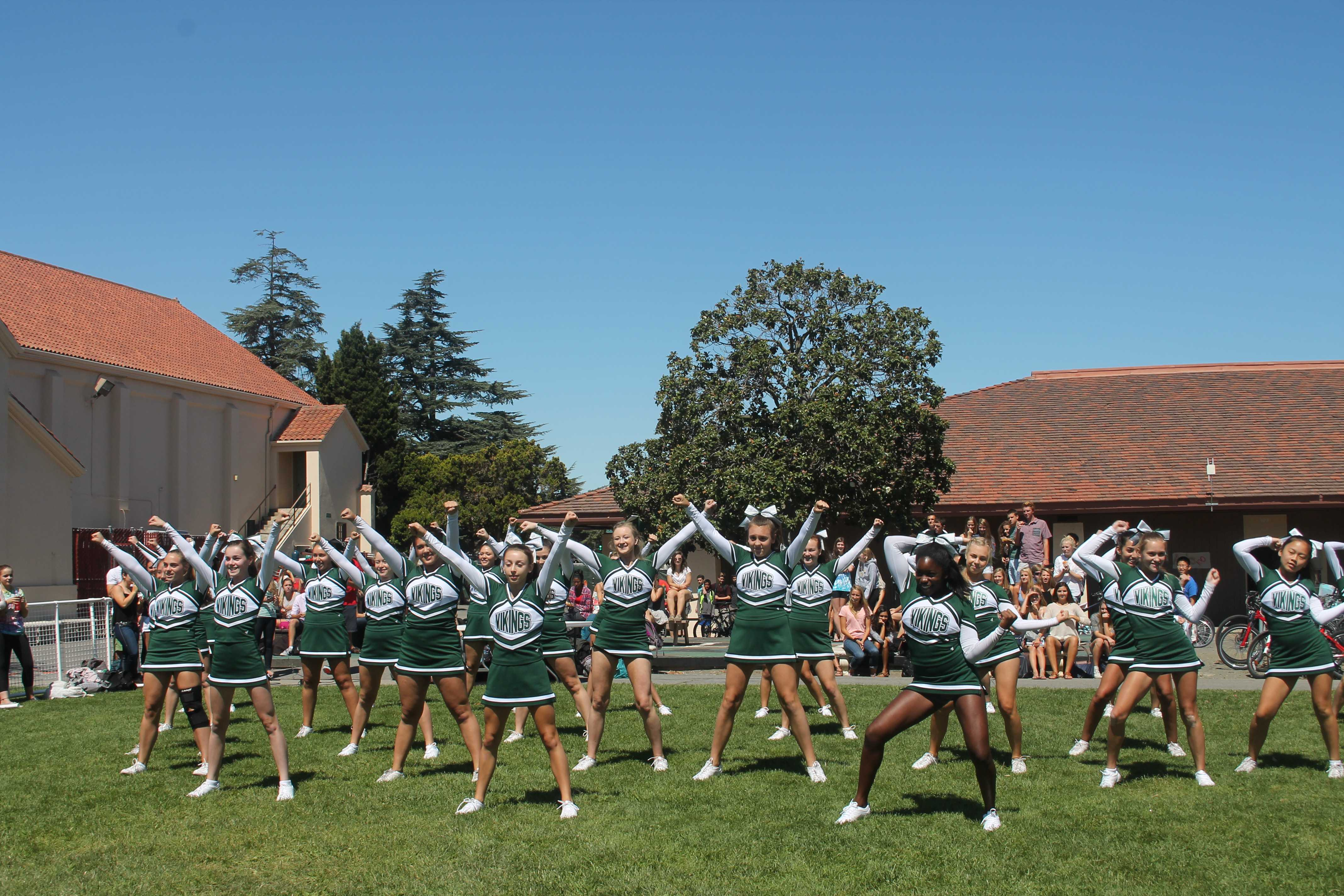 The Paly Cheer Team strikes a pose on the Quad during the first rally of the year. Photo by Chloe Fishman.