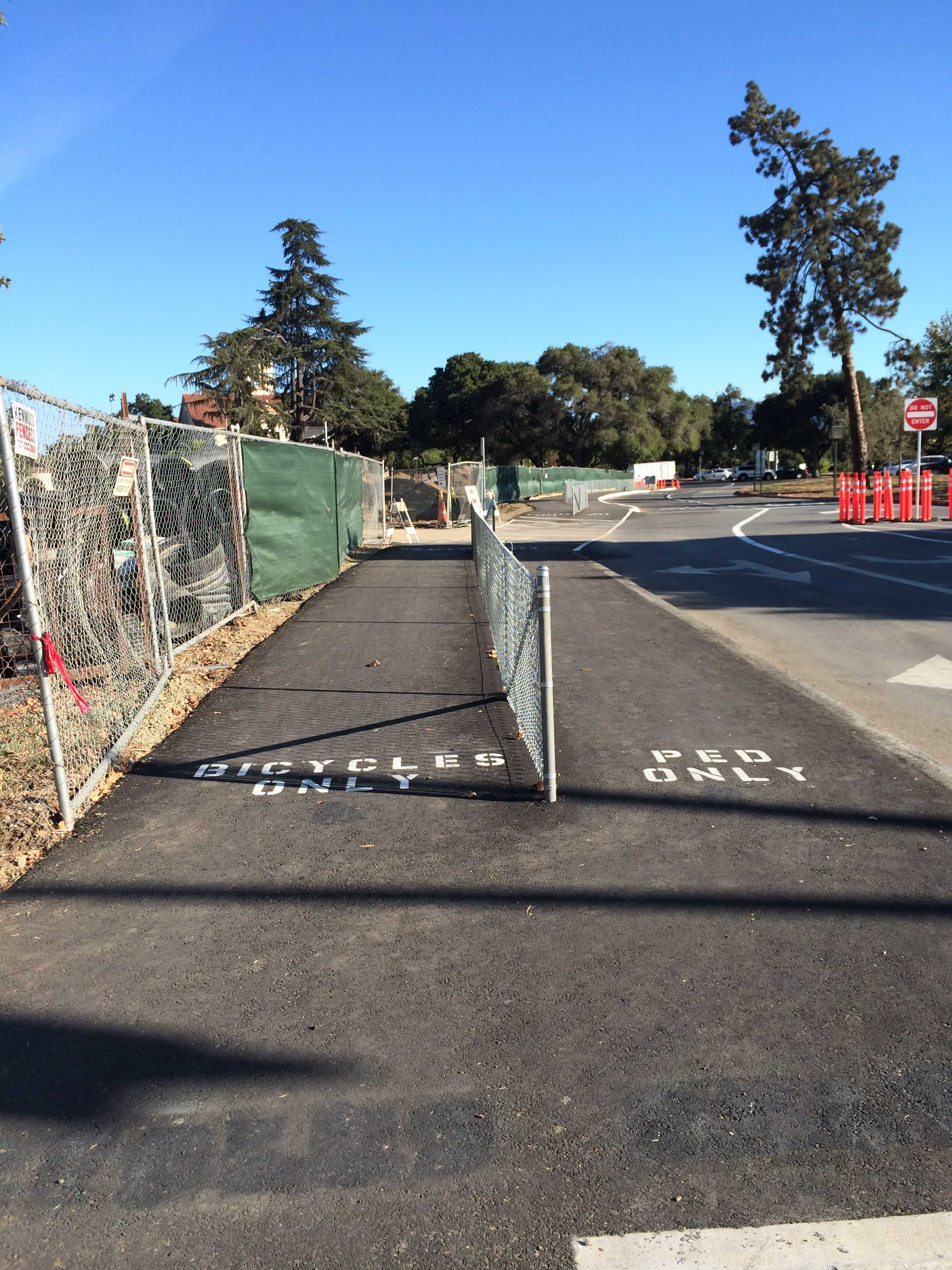 New walkways have been set up to accommodate expected pedestrians and bikes coming through the parking lot. Photo by Maddy Jones.