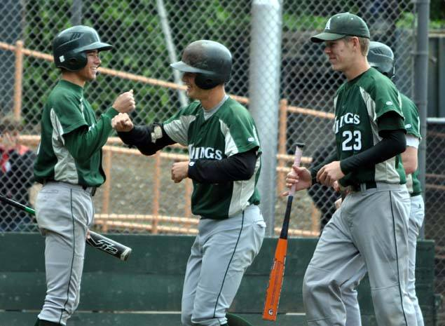 Pederson high fives a teammate after hitting a home run for the Vikings. Photo by the Viking Magazine.