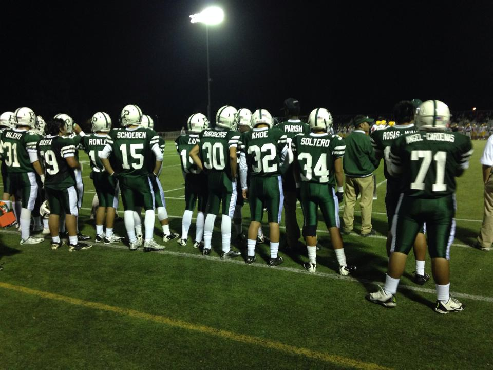Members of the Palo Alto High School football team observe the game action from the home sideline. The Vikings lost their third straight game Friday night vs. Palma