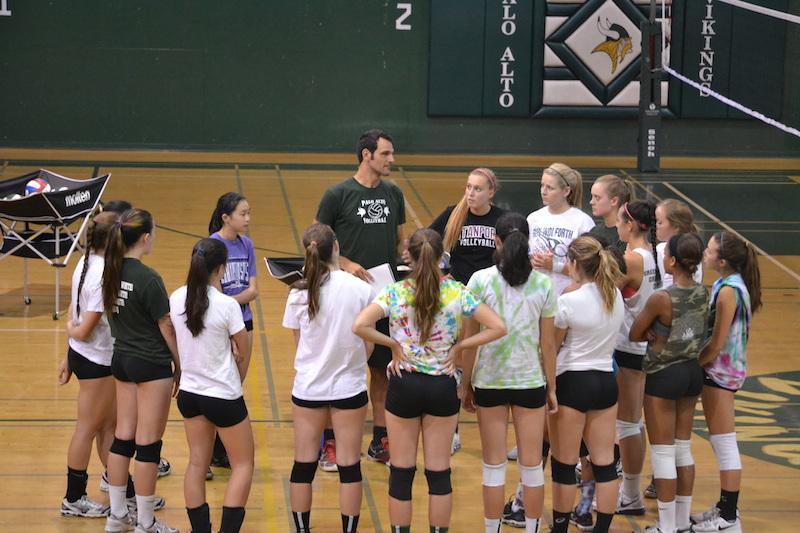 The Palo Alto High School girls' volleyball team discusses season plans before practice. Photo by Amy Leung.