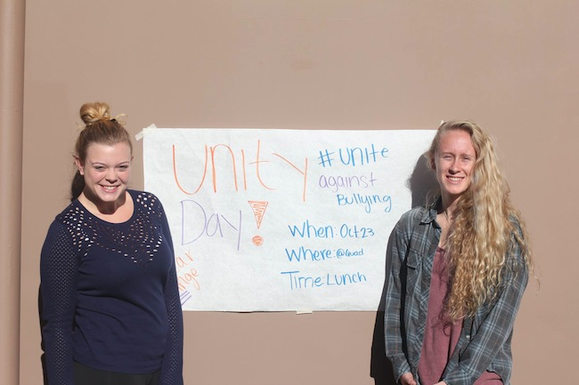 Unity Club leaders, Rebecca Segars and Siggi Benston, are helping to organize Unity Day tomorrow. Paly students are asked to wear orange and participate in lunchtime activities in order to show their support against bullying. Photo by George Lu.