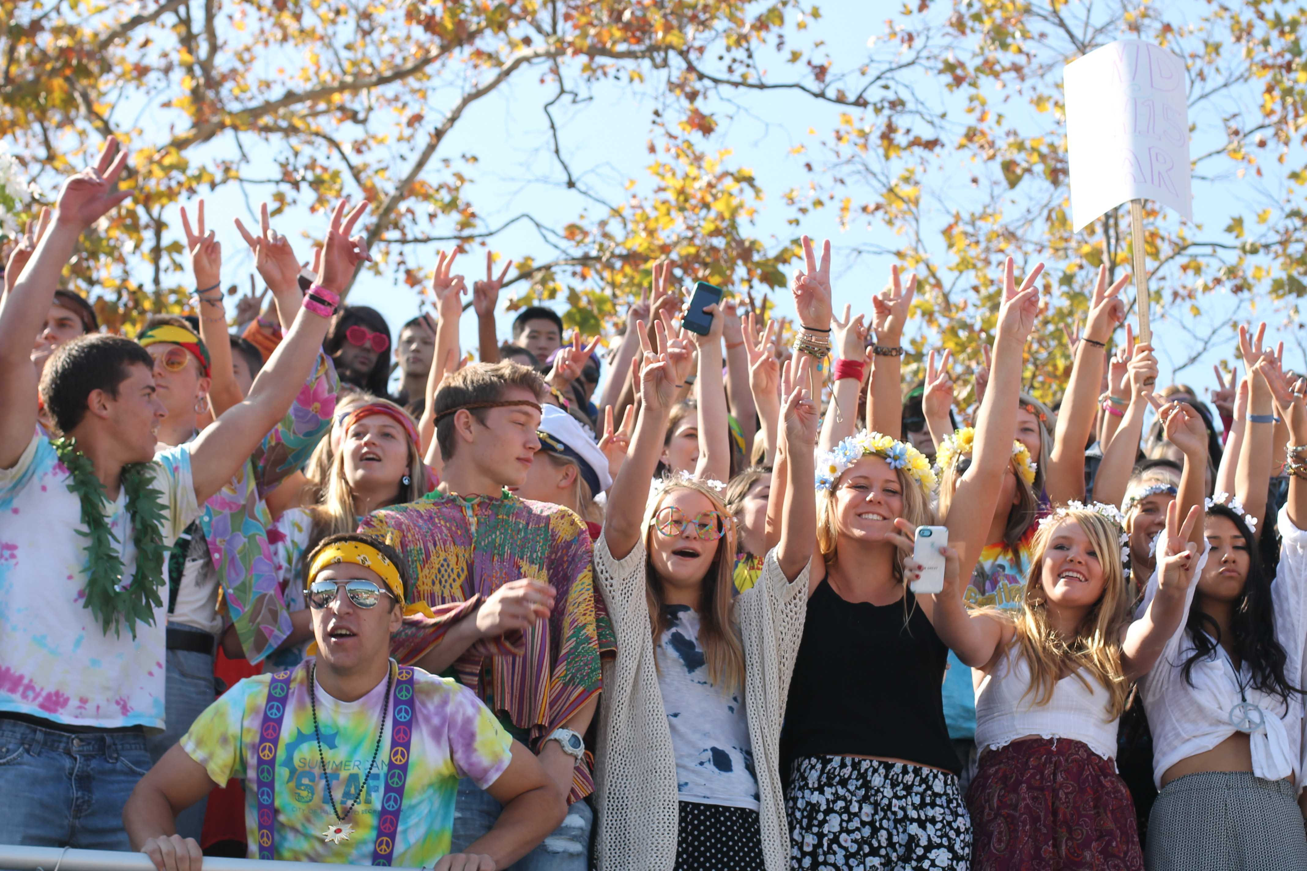 "The juniors cheer during Spirit Week 2013.  Juniors dressed as hippies to follow along with their theme of ""Yellow Submarine."" Photo by Molly Fogarty and Cathy Rong."