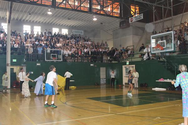 Senior Kevin Mullin shoots a three-pointer to secure the seniors a spot in the boys' finals. Photo by Ana Caklovic.
