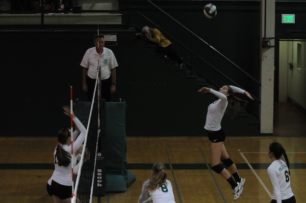 Senior captain and right side hitter Anna Dukovic prepares to kill the ball. Dukovic had the most kills of the night for the Vikings with 18  kills and had a streak of three kills in a row in the second set. Photo by Liana Pickrell.
