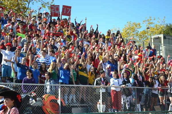 """The class of 2017 dons soccer uniforms in honor of their theme """"red card"""" during spirit week 2014. The theme was also a result of a re-vote after controversy over their first theme. Photo by Adele Bloch."""