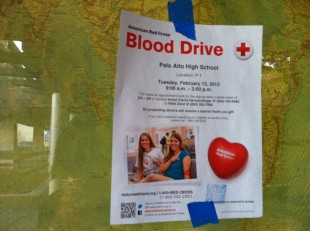 A poster advertising the blood drive hangs on the window of a classroom for last year's blood drive. Photo by Noa Braun and Paige Esterly.