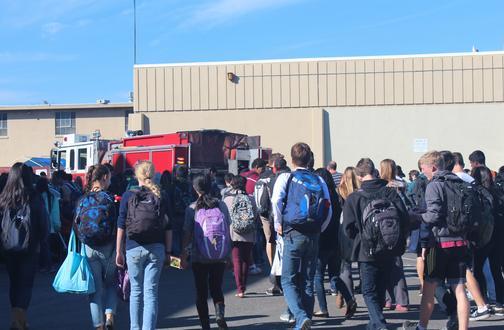 Students pass a firetruck as they make their way to the field. .According to National Fire Protection Association, the U.S. fire departments responded to 2,238,000 false alarms in 2012, which corresponds to one false alarm for every twelve calls the fire department receives. Photo by Ana Caklovic