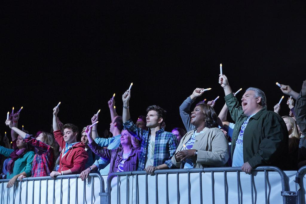Cast of Parks and Recreation wave glowsticks at the during the season 6 finale. Photo from NBC Universal