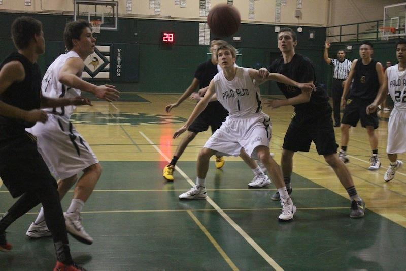 Sophomore forward Max Dorward boxes out his opponent in a home game against Wilcox High School last season. The team went on to Central Coast Section playoffs, losing against Santa Teresa high school and ending their season. Photo by Josh Yuen.
