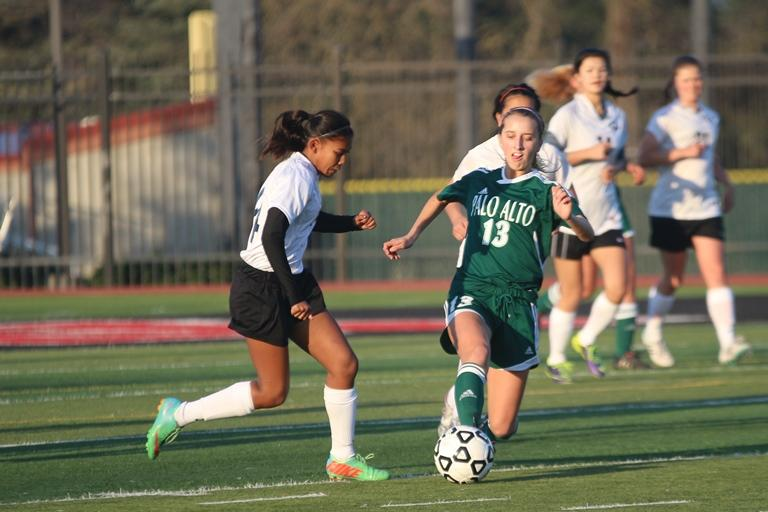 Senior midfielder Katie Foug pushes the pall past a Gunn player. Foug scored one goal. Photo by Maddy Jones.