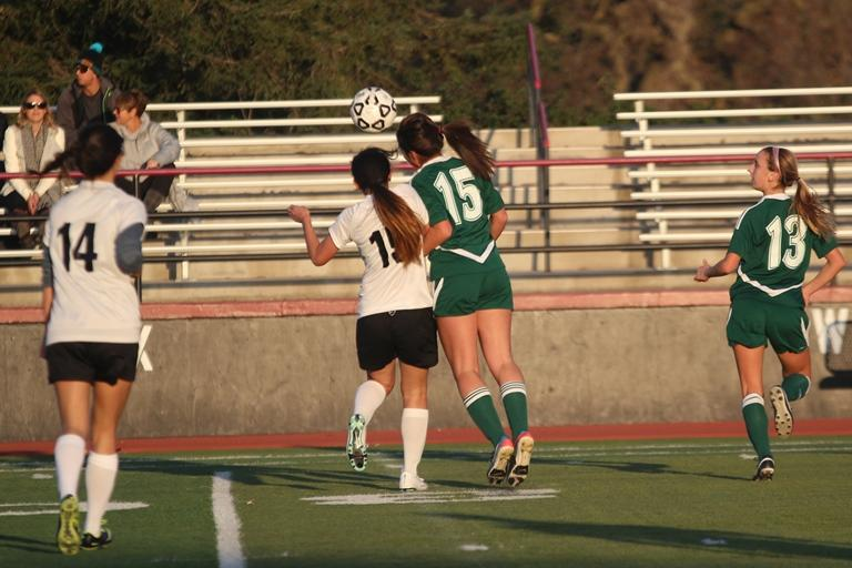 Sophomore midfielder Natalie Maloney goes up for a header.  Maloney had one assist and one shot on goal. Photo by Maddy Jones.