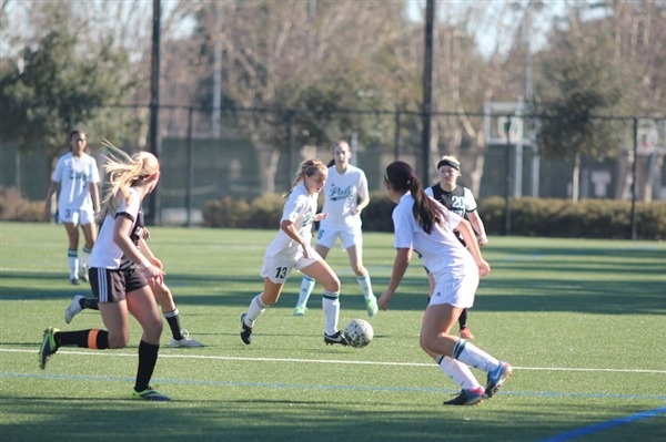 Senior midfielder Katie Foug carries the ball forward into the Los Gatos half. Paly beat Los Gatos 2-0. Photo by George Lu