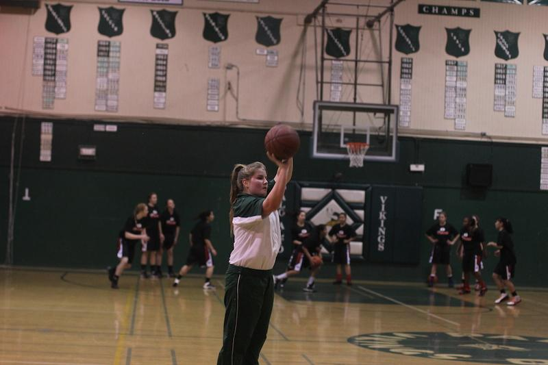 Frick warms up behind the three-point line prior to a game vs. Gunn High School. Frick was one of two freshmen on the girls' team this season. Photo by George Lu.