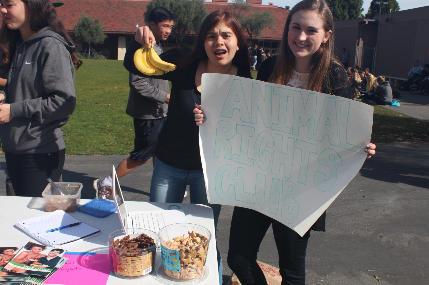 Junior club founders Chelsea McIntosh and Danielle Bisbee advertise for their club, which urges students to stand up against animal cruelty.
