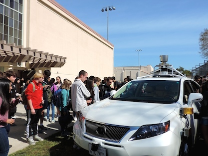 Paly students surround and look at a Google self-driving car. Jamie Waydo came to speak at Paly as part of the Career Month Speaker Series on March 9.