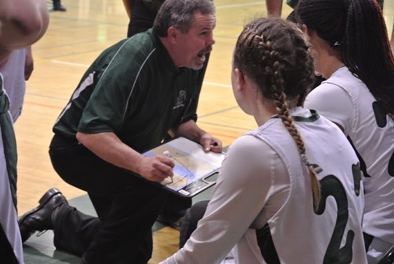 Vikings head coach Scott Peters challenges his players during a game against Gunn High School on Feb. 7. The girls' team is expected to have all of its players return next season. Photo by Dhara Yu.