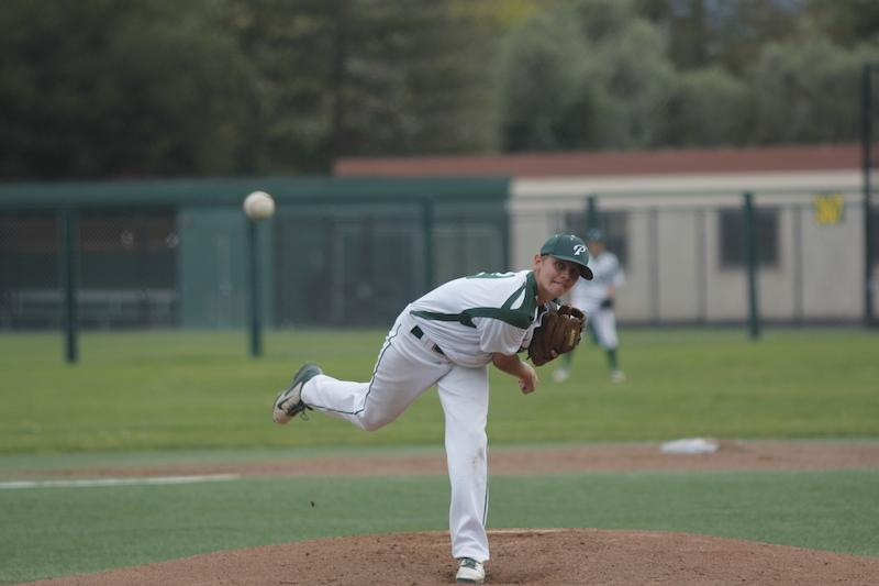 Senior pitcher Isaac Kasevich pitches the ball. Kasevich pitched for the first six innings, before being relieved by senior pitcher Corey Bicknell in the seventh. Photo by George Lu.