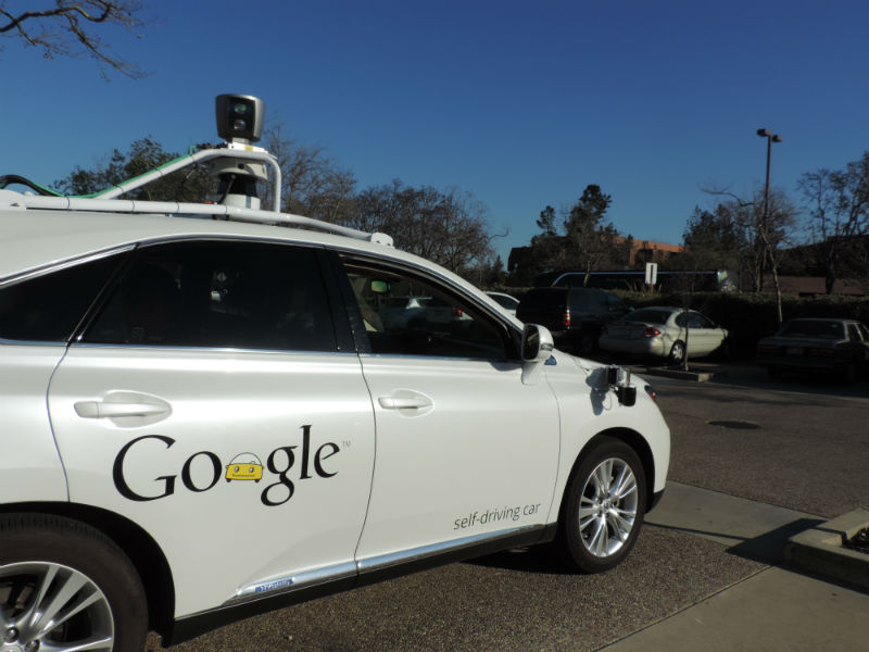 """A self-driving car parks in the Google parking lot. """"We've been working on that [designing our own cars] for about the last two years,"""" Waydo said. """"It allows us to customize both what the sensor sees and all the computing."""" Photo by Jeanette Wong."""