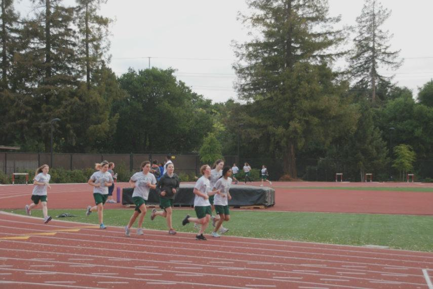 Students from Palo Alto High School Physical Education teacher Stacey Kofman's Zero Period PE class jog around the track. Photo by Jeanette Wong.