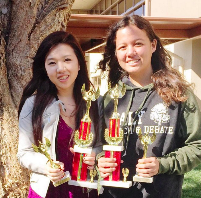 Juniors Anna Lu and Anna Nakai pose for a picture after co-championing in the varsity division at the Santa Clara Philalethic Invitational tournament. This tournament marked the first time over twenty years that four Paly debaters have ever co-championed both the varsity and novice divisions of a tournament. Photo by Anna Lu.