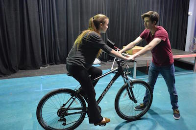"Sophomore Zoe Sego plays the lead character Ora. Junior Ophir Sneh holds onto the ""ghost bike."" Photo by Ido Gal."